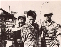 vietcong prisoner being led [&] soldiers with   prisoner [&] executioner holstering pistol [and] others by eddie adams